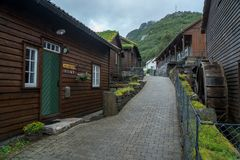 Traditional norwegian wooden house. Typical Norwegian house. Typical norwegian house with grass on the roof stock photos