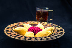 Traditional Novruz cookies on black background. Traditional Novruz plate with cookies shekerbura, pakhlava Royalty Free Stock Images