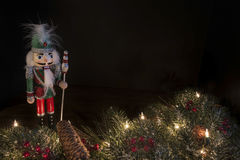 Traditional nutcracker with decorative pine border and a black background Royalty Free Stock Images