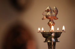 Traditional Oil Lamp with Flame Stock Image
