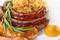 Traditional Oktoberfest menu, plate of sausages and sauerkraut Royalty Free Stock Image