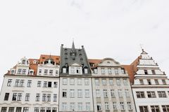 Traditional old architecture in Leipzig in Germany. Traditional old architecture on the main square in Leipzig in Germany. Reential buildings with many windows stock image