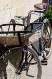 Traditional old bike with basket Stock Images