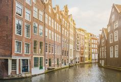 Traditional old building facade in Amsterdam along the canal coa. St , city center Stock Photo