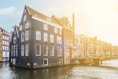Traditional old building facade in Amsterdam along the canal coa. St , city center Royalty Free Stock Images