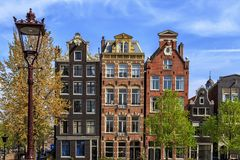 Traditional old buildings in Amsterdam. Royalty Free Stock Photos