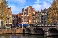 Traditional old buildings in Amsterdam. Stock Photos