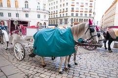 Traditional old-fashioned fiacres at  Michaelerplatz near Hofburg of Vienna, Austria. Royalty Free Stock Photos