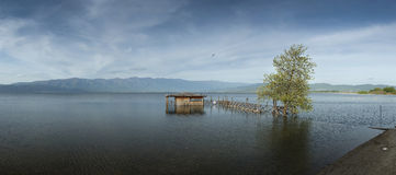 Traditional old fishing hut and wooden pier at Lake Dojran Royalty Free Stock Image