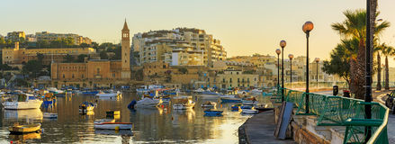 Traditional old fishing village Marsaskala at sunrise in Malta. Traditional old fishing village Marsaskala in Malta at sunrise Royalty Free Stock Image