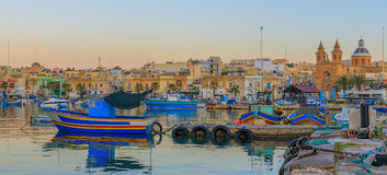 Traditional old fishing village Marsaxlokk in Malta. At sunrise Royalty Free Stock Image
