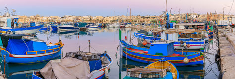 Traditional old fishing village Marsaxlokk in Malta. At sunrise Stock Photo