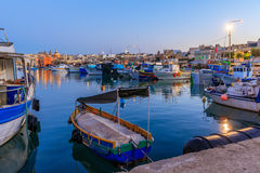 Traditional old fishing village Marsaxlokk in Malta. At sunrise Stock Image