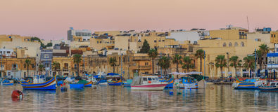 Traditional old fishing village Marsaxlokk in Malta. At sunrise Royalty Free Stock Photos