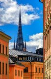 Traditional old gothic buildings and Riddarholmen Church in Sto. Traditional gothic buildings and Royalty Free Stock Images