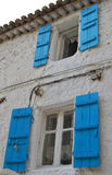 Old house. Traditional old greek house with blue windows Royalty Free Stock Image