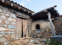 Traditional old  house exterior. Traditional house exterior courtyard with clay oven at the village of Fikardou in Cyprus Stock Photos