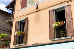 Traditional old house with wooden blue shutters and twisted balcony . Tourist attraction Monte Isola, Italy Royalty Free Stock Images