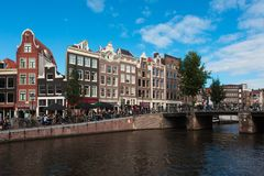 Traditional old houses and boats on Amsterdam canal Stock Photo