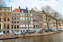 Traditional old houses, canal, bridge, bikes in Amsterdam, Netherlands Stock Photography