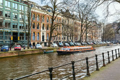 Traditional old houses, canal, bridge, bikes in Amsterdam, Netherlands Royalty Free Stock Photo