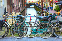 Traditional old houses, canal, bridge, bikes in Amsterdam, Netherlands Royalty Free Stock Image