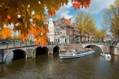 Traditional old houses on canal at fall day in Amsterdam, Nether stock image