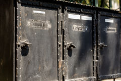 Traditional old letterboxes. Old post boxes of metal - traditional communication royalty free stock photos