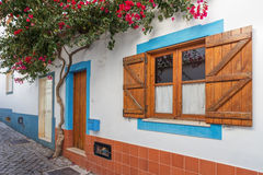 Traditional old Portuguese street with decorative window. Stock Photos