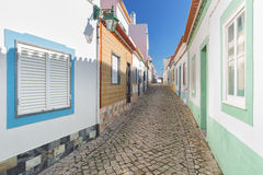 Traditional old Portuguese street with stone lane. Royalty Free Stock Images
