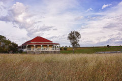 Traditional old Queenslander house. Typical old Queenslander style wooden house with wide verandahs set in paddocks in the countryside Stock Image