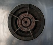 Traditional old and rusty gas stove burner head made with cast i Royalty Free Stock Images