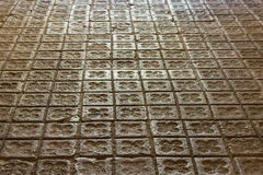 Traditional old simple floor tiles with a floral pattern in Barc Royalty Free Stock Photography