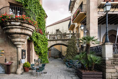 Traditional old Spanish street with beautiful balconies and arches in Barcelona town, Spain.  stock photo