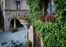 Traditional old Spanish street with beautiful balconies and arches in Barcelona town, Spain Royalty Free Stock Images
