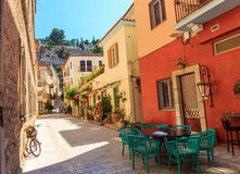 Traditional old style street in Greece. Beautiful traditional old style street in Greece Royalty Free Stock Images