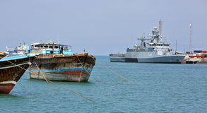 Traditional old style wooden fishing and cargo ships and EU WARSHIP F-262 Royalty Free Stock Images