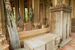 Traditional old teak wood furniture outside of the Hor Phra Keo temple and Museum in Vientiane, Laos. VIENTIANE, LAOS - APRIL 23, 2012: Traditional old teak Royalty Free Stock Photo