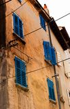 Details of a traditional old house with wooden blue shutters Royalty Free Stock Photography