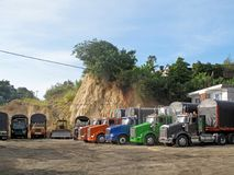 Traditional old trucks of various colors and models are in row on a truck stop in Ocana, Colombia Stock Photography