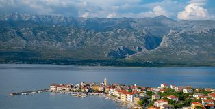 Traditional old village Vinjerac, Croatia, Velebit mountains and Paklenica national park in background stock images