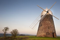 Traditional old windmill at sunset Royalty Free Stock Image
