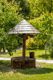 Traditional old wooden well and bucket Stock Photo