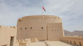 Traditional Omani fortress, general plan and details, a flag on the main tower.