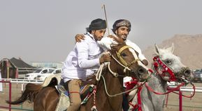Traditional omani horse race. Ibri, Oman, 28th April 2018: omani men at a traditional horse race event where young riders show their skills Stock Images