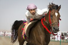 Traditional omani horse race. Ibri, Oman, 28th April 2018: omani men at a traditional horse race event where young riders show their skills royalty free stock images