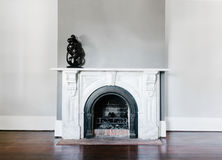 Traditional open fireplace with marble surround and mantle Royalty Free Stock Images