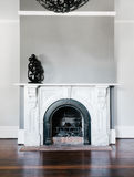 Traditional open fireplace with marble surround and mantle. Stock Image