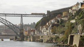 Traditional Porto neighborhood. Old Porto seeing Douro river border, medieval Fernandina wall and a traditional neighborhood upstream D. Luis iron bridge royalty free stock image