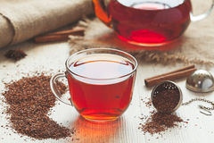 Traditional organic rooibos tea in rustic style. Healthy traditional organic rooibos tea with spices in rustic style with faded instagram filter on vintage Royalty Free Stock Photos